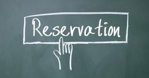 finger click reservation symbol on blackboard
